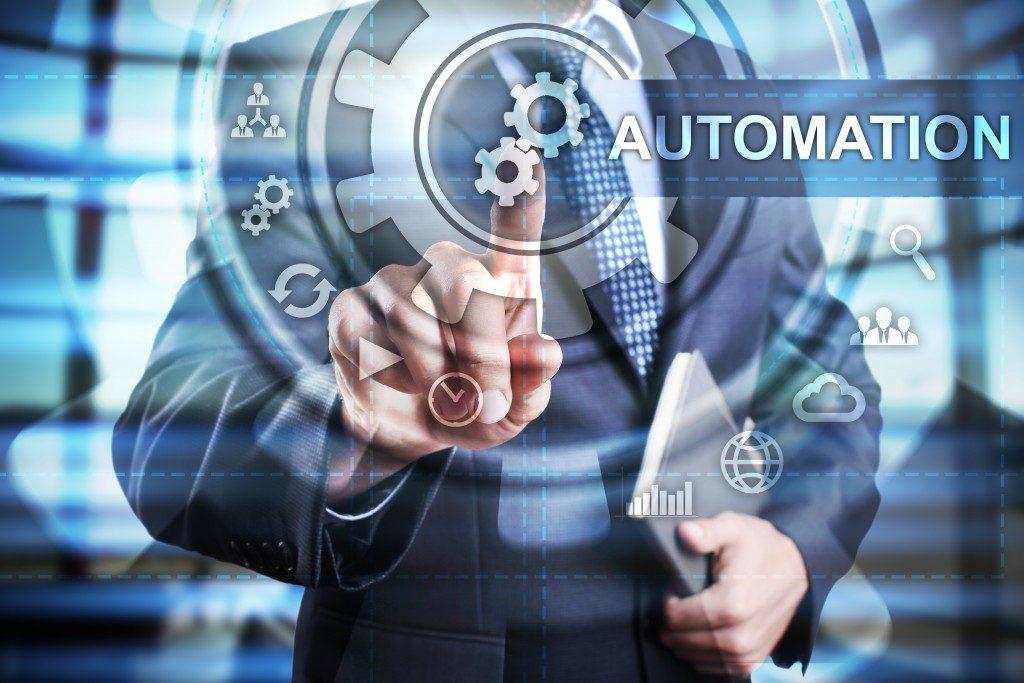 Businessman clicking an automation button