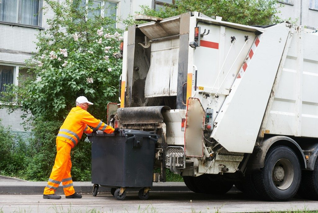 trash collector and garbage truck