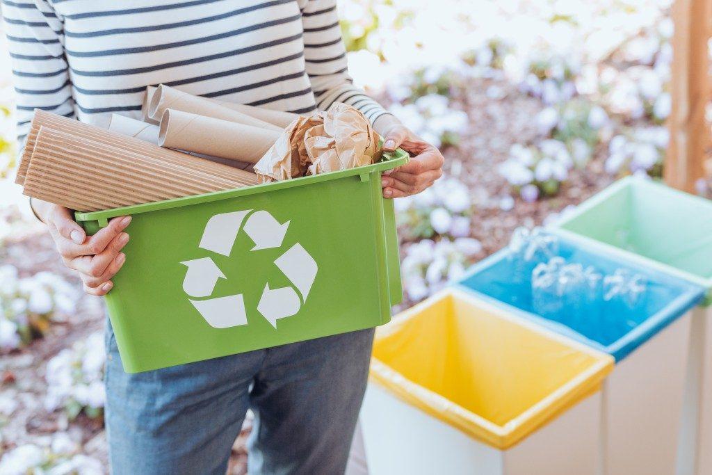woman recycling trash