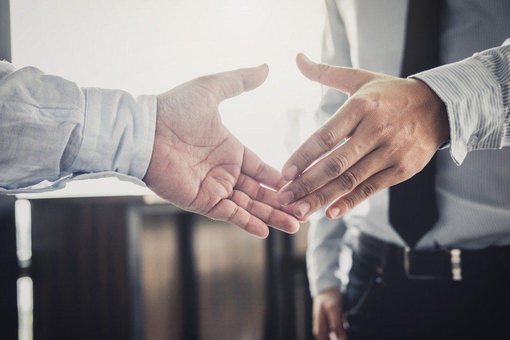 handshake between two employees