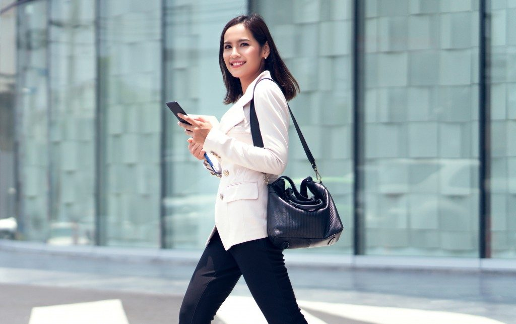 career-driven woman happily walking