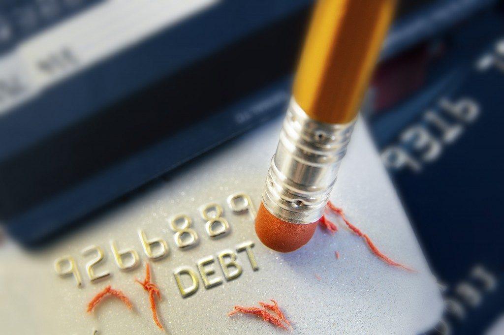 Erasing credit card debt concept