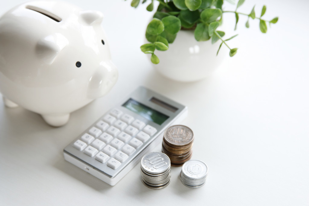 money box and electronic calculator