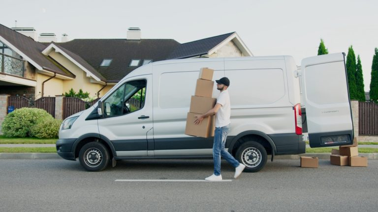 delivery man holding some boxes
